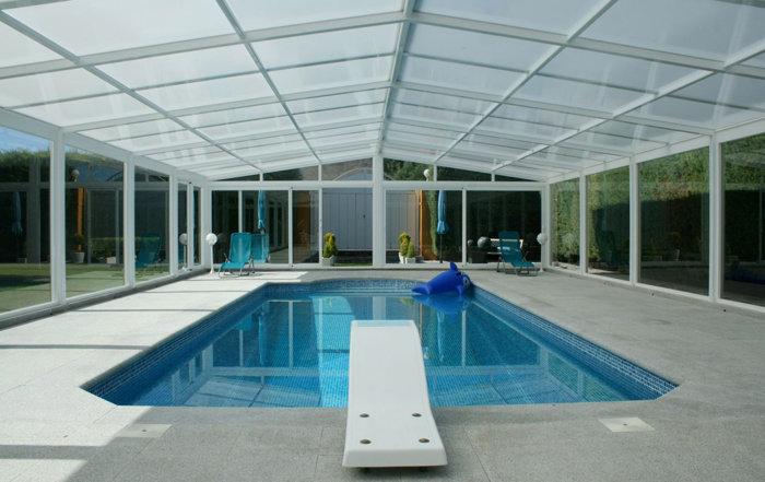 Cubiertas para piscinas y cerramientos tecnyvan somos for Climatizar piscina