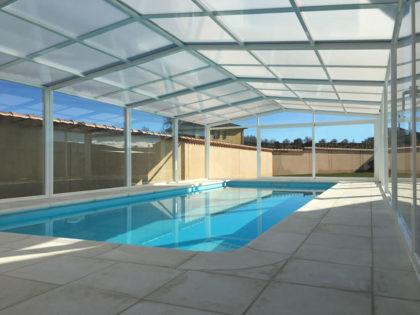 Cubierta Vulcano: Cerramiento de policarbonato alto y fijo para piscina en Ávila